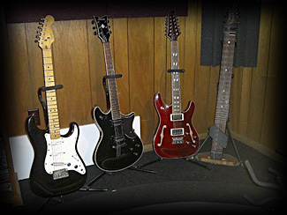 Some of Har's instruments: (L-R) Fender Stratocaster, Schecter Tempest Blackjack, Schecter C/SH-12, 10-string Chapman Stick